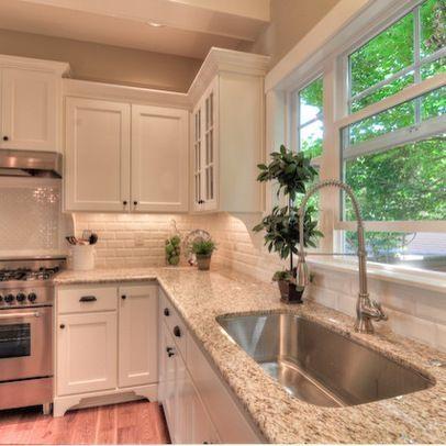 Giallo Ornamental Granite Countertop Installation in Saylorgsburg, PA | Aqua Kitchen & Bath Design Center