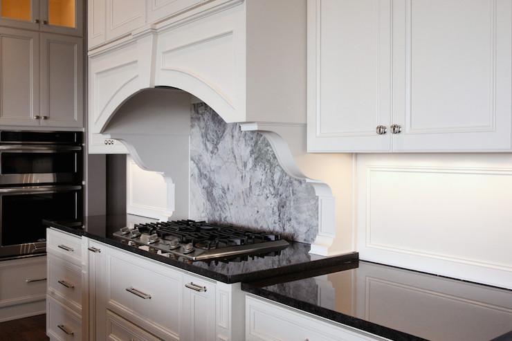 super white quartzite backsplash for black granite countertops
