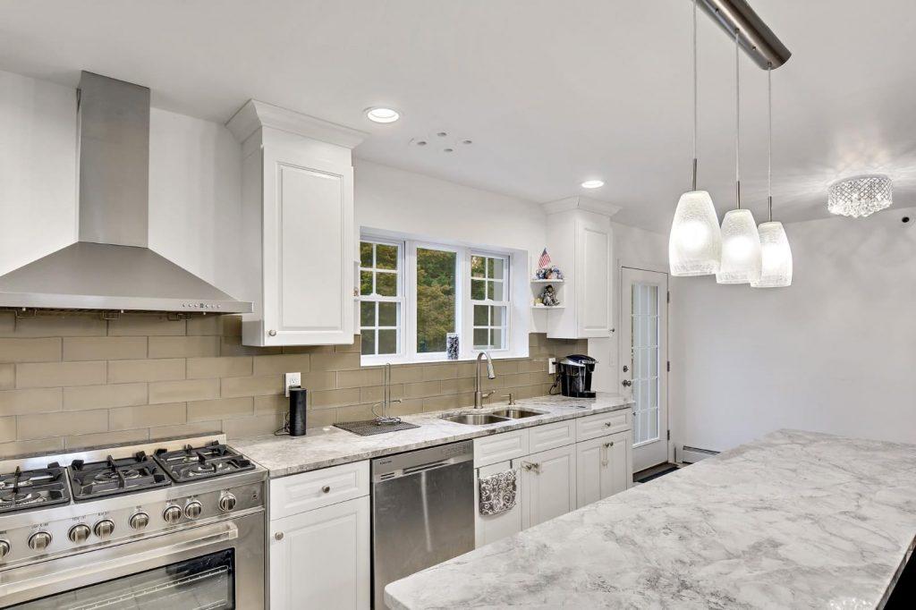 Super White Quartzite Project by Aqua Kitchen and Bath Design Center