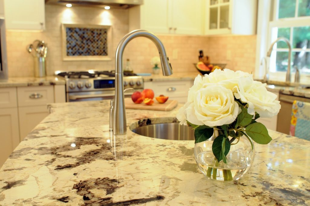 Delicatus White Granite with White Cabinets