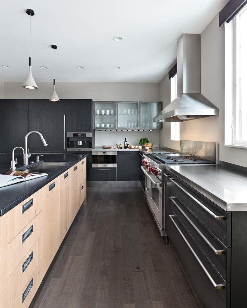 Black kitchen cabinets with dark quartz countertops
