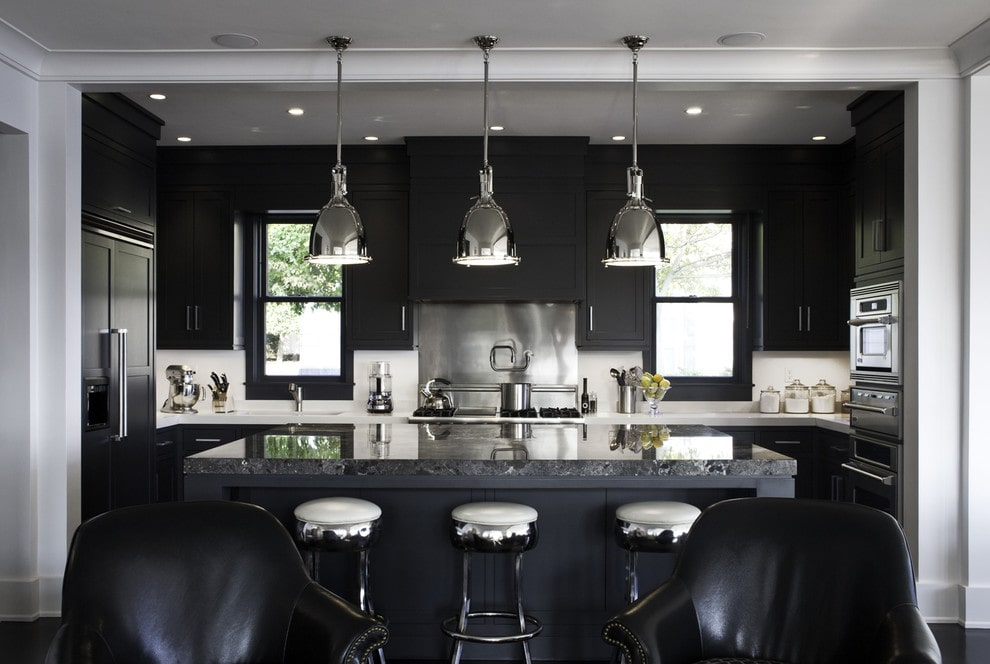 Black kitchen cabinets with marble countertops
