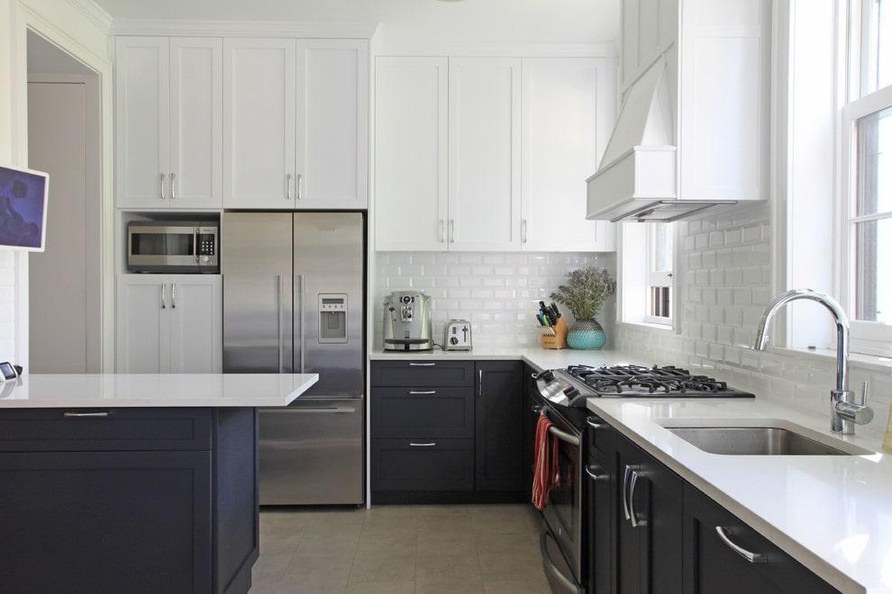Dark base cabinets with upper white cabinets design by Maletz Design