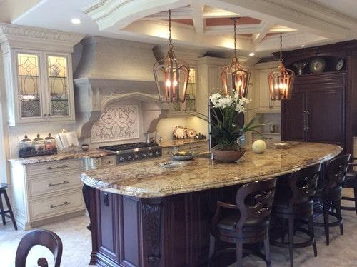 Mediterranean kitchen design with dark and light cabinets