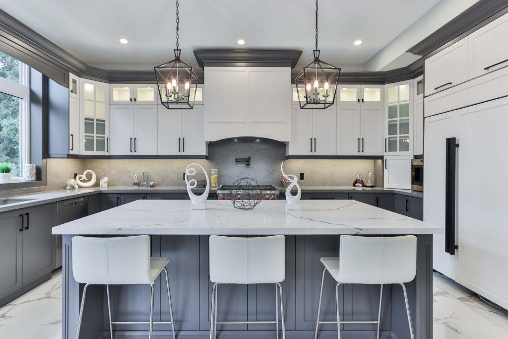 Two-toned white and gray kitchen with white quartz countertops